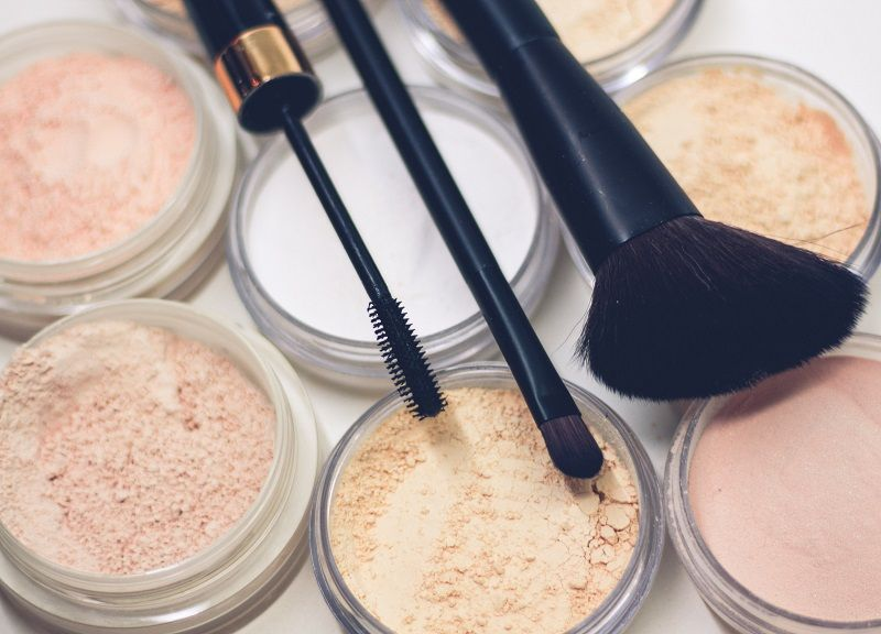 Makeup foundation in different shades with brushes