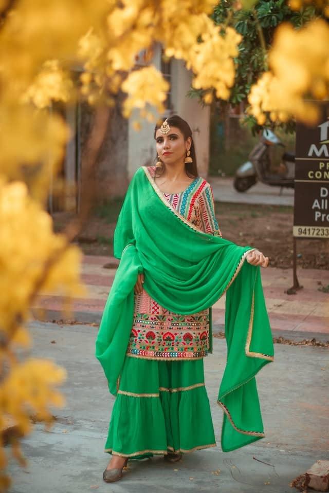 A woman wearing Green Salwar Kameez