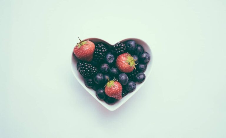Healthy fruits are placed in a heart shaped bowl