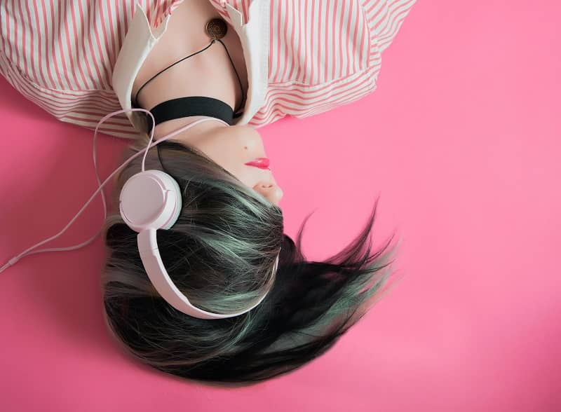 A girl listening music while sleeping