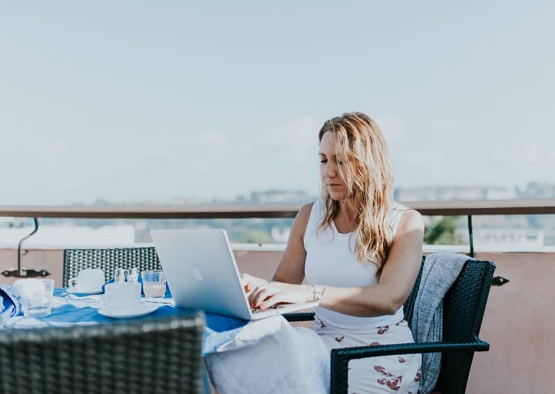 A remote worker working from a rooftop restaurant