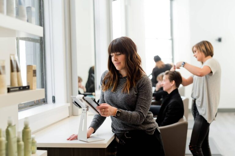 A Salon owner consulting via video call on a tablet