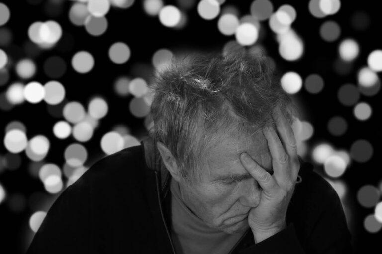 An upset old man having Alzheimer's disease