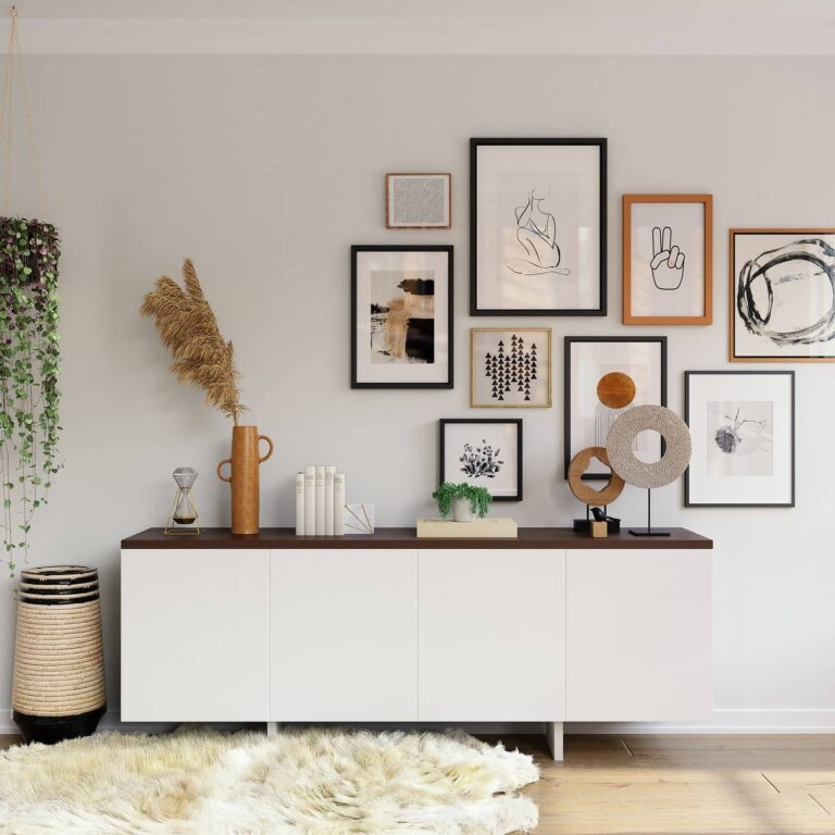 A decorated home room with beautiful paintings, plants, tiles and decorative items