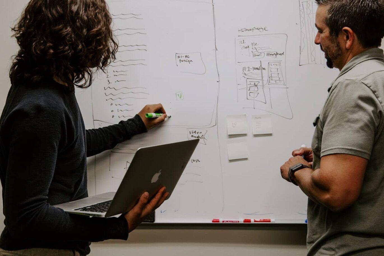 Intelligence analyst explaining data on a white board