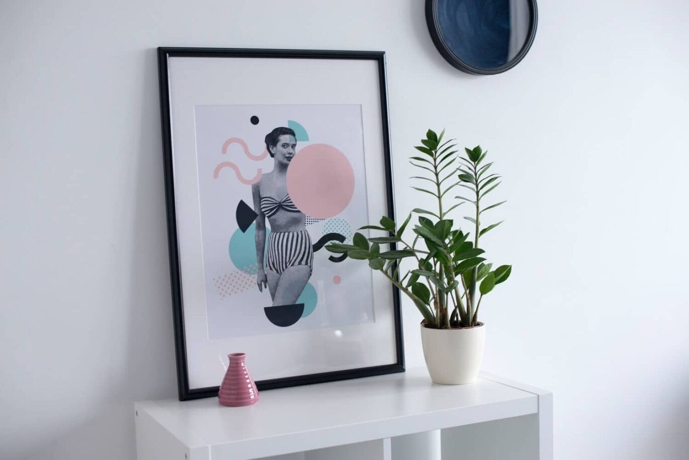 A photo frame and a round wall art